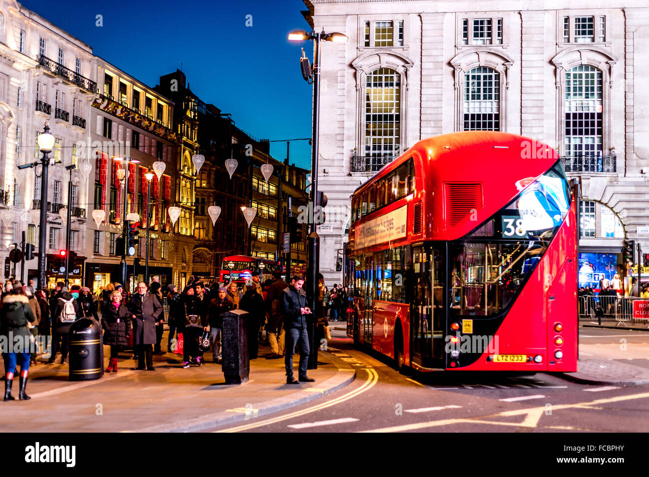 Red London bus at Picadilly Circus, London - Stock Image