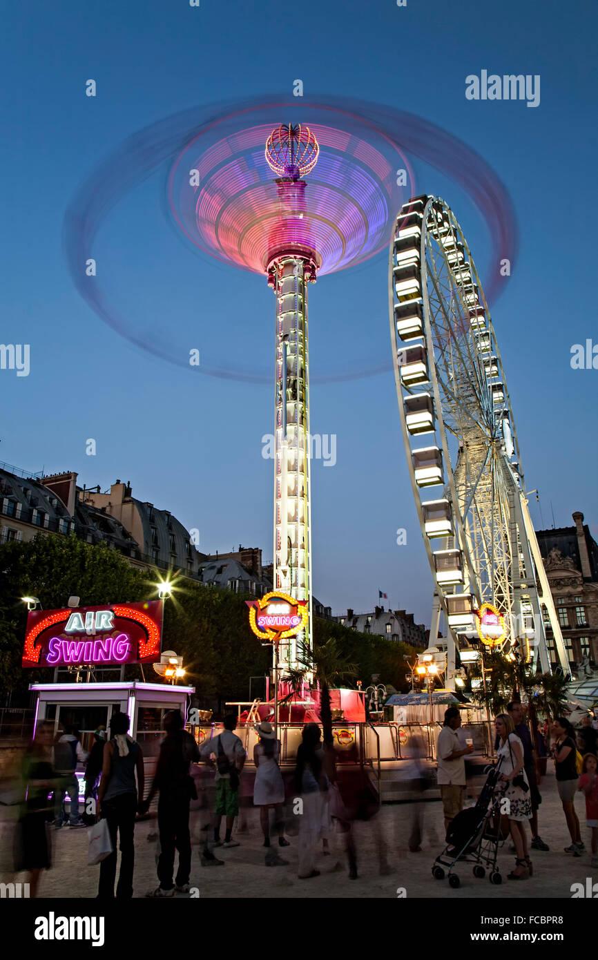 'Air Swing' and Ferris wheel, Tuileries Garden, Paris, France - Stock Image