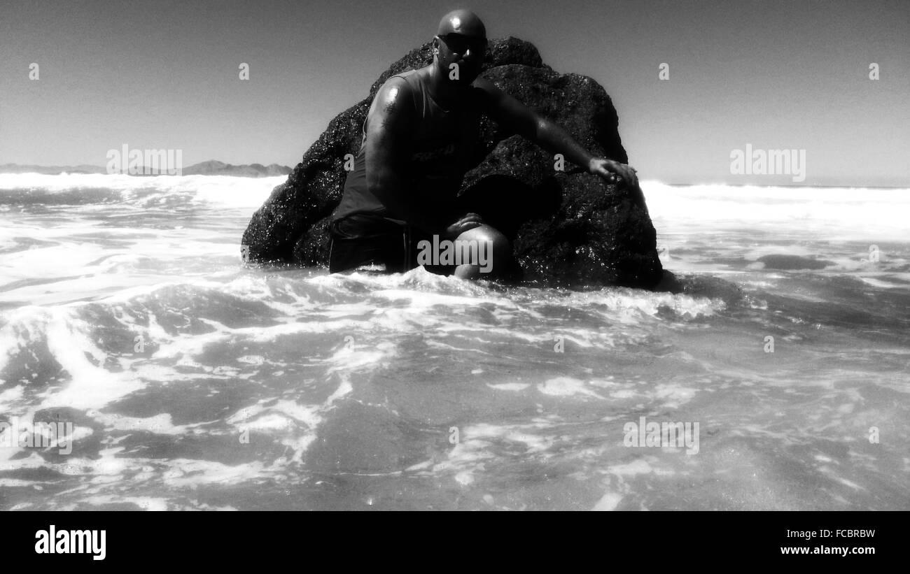 Man Enjoying In Sea - Stock Image