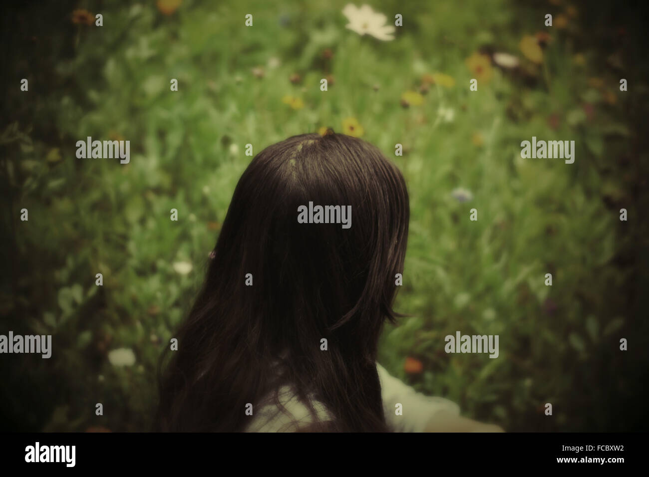Woman Sitting In The Garden - Stock Image