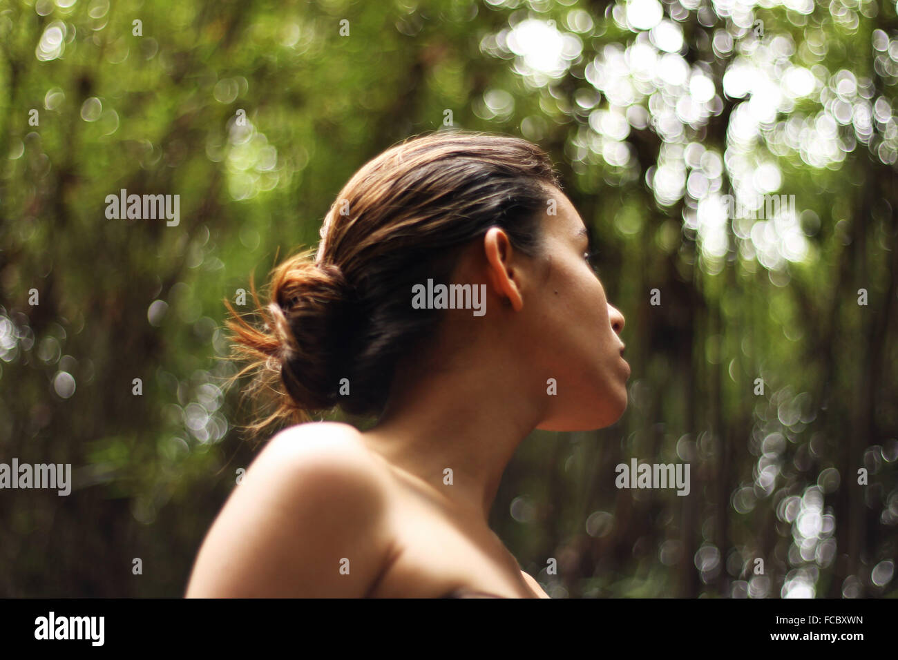 Close-Up Of Young Woman Looking Away - Stock Image