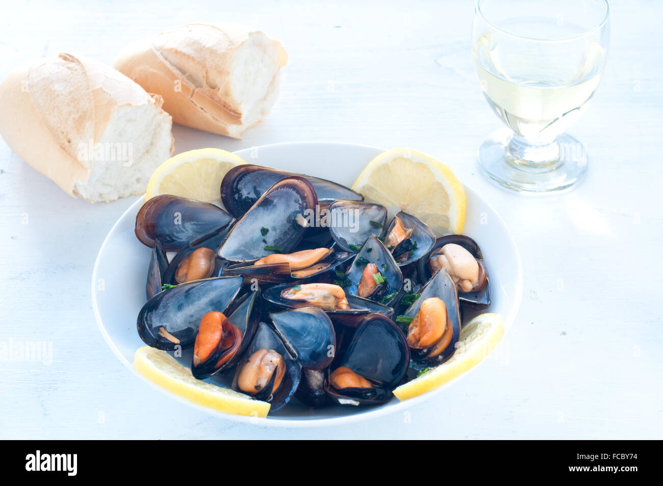 Cooked mussels marinara with tomato, garlic and olive oil, italy - Stock Image