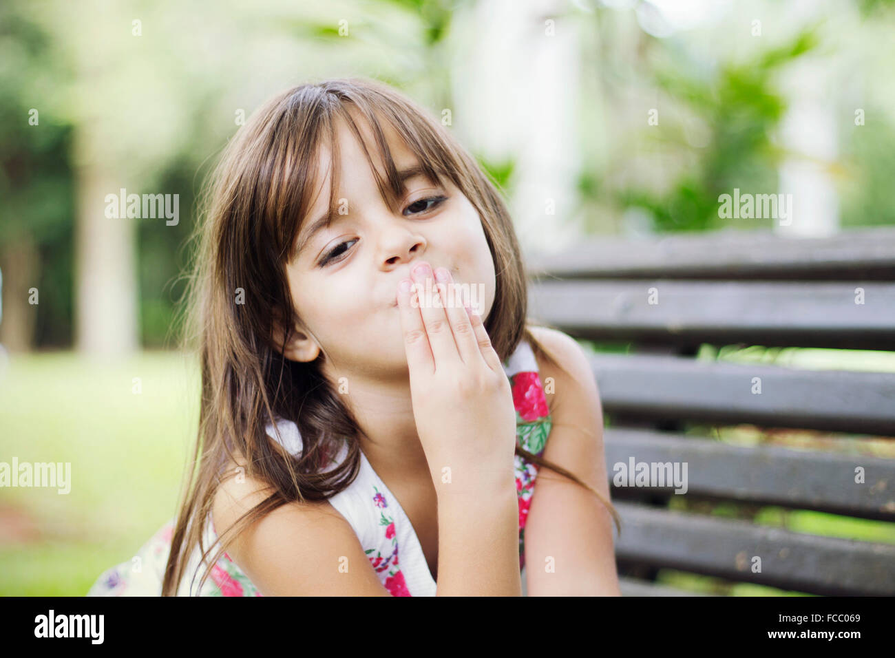 Portrait Of Cute Girl Blowing A Kiss - Stock Image