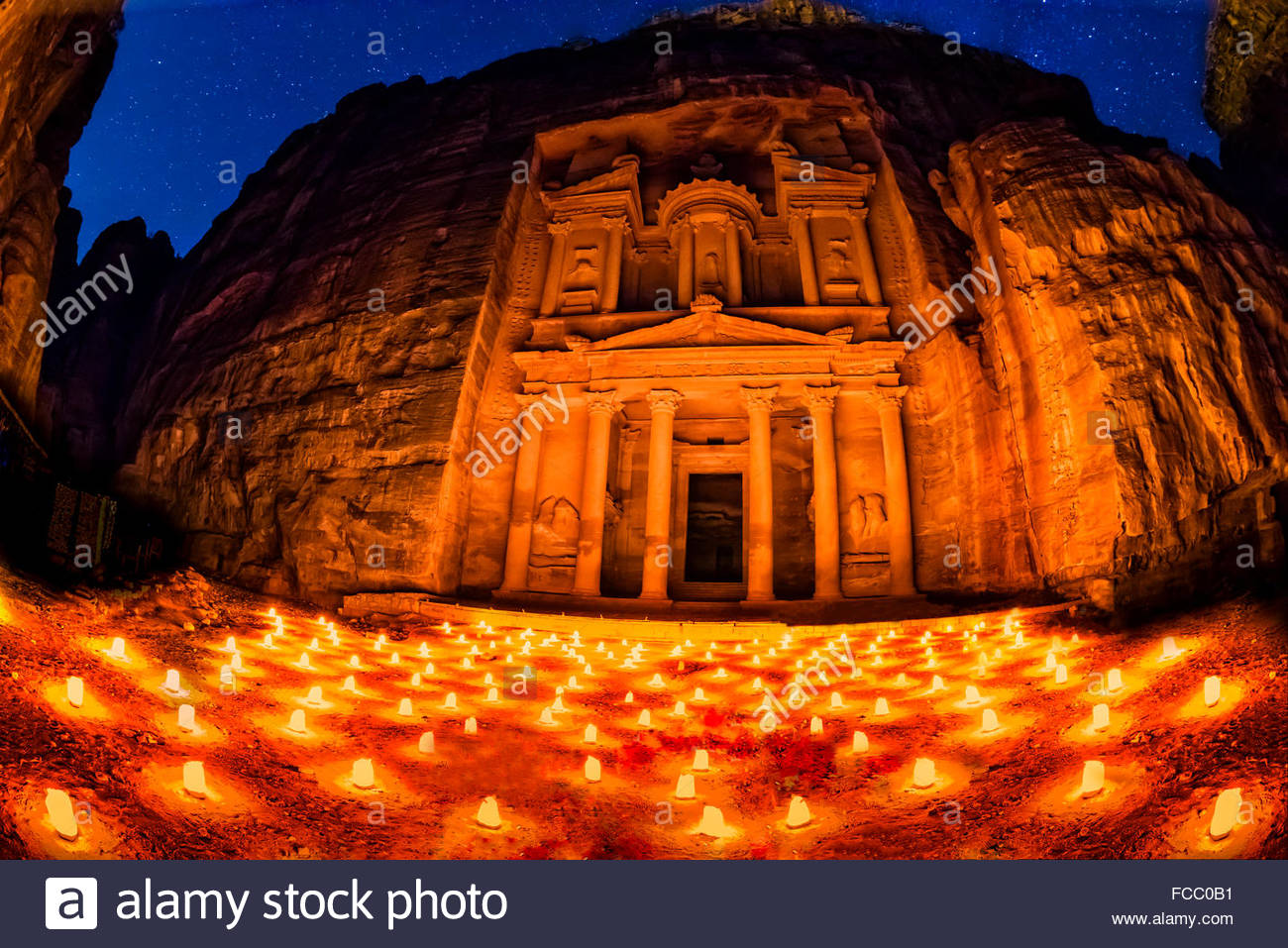 Petra by night (candlelit), The Treasury monument (Al-Khazneh), Petra archaeological site (a UNESCO World Heritage - Stock Image