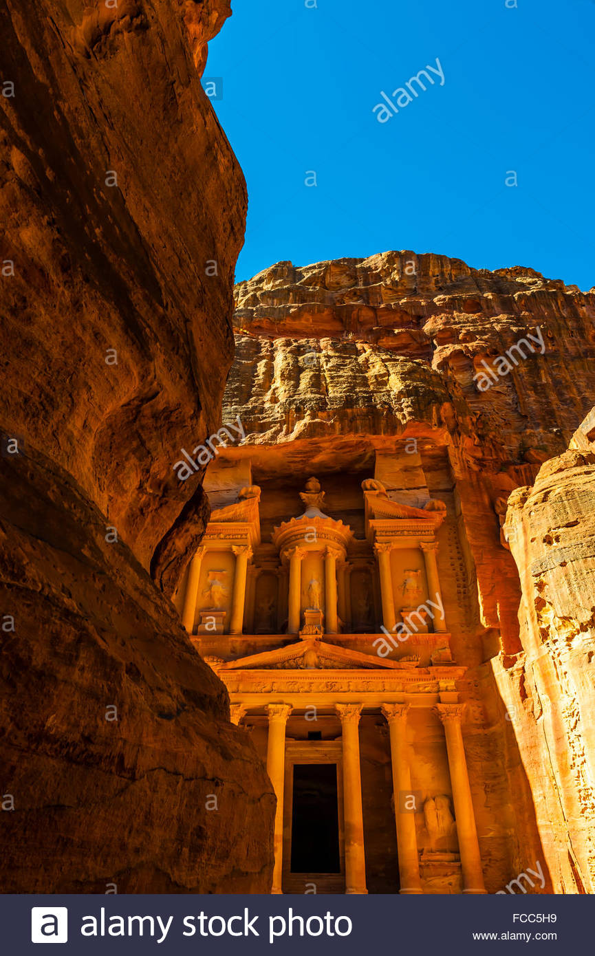 Looking from The Siq (gorge) to The Treasury (Al-Khazneh), Petra Archaeological Park (a UNESCO World Heritage Site), - Stock Image