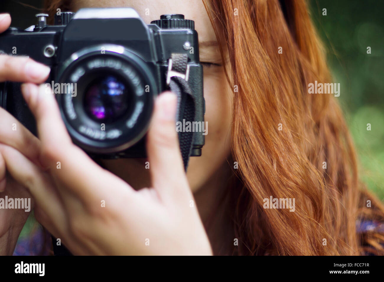 Close-Up Of A Female Photographer Stock Photo