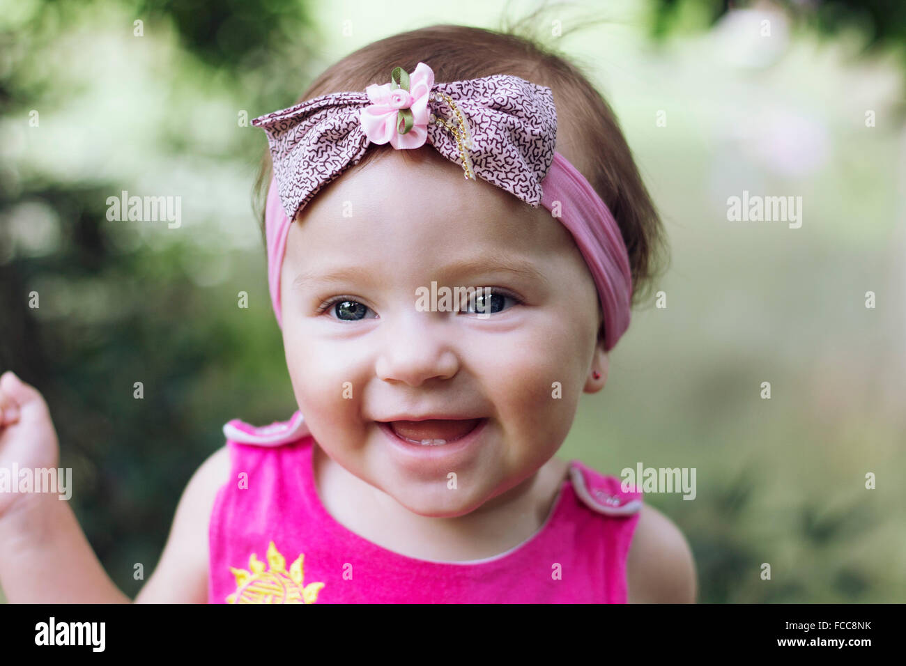 Close-Up Of A Cheerful Baby Girl Stock Photo