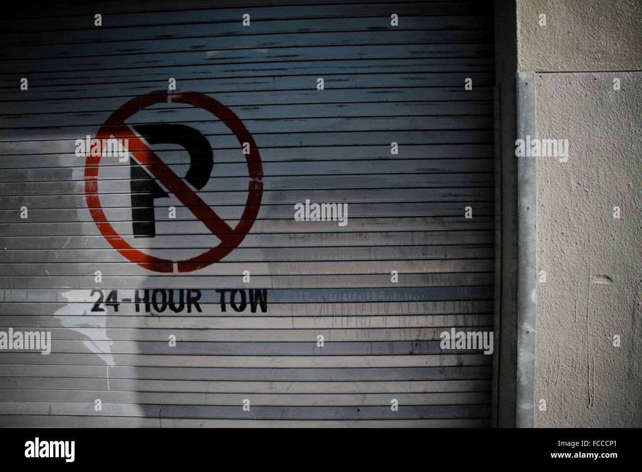 No Parking Mentioned On Closed Shutter - Stock Image