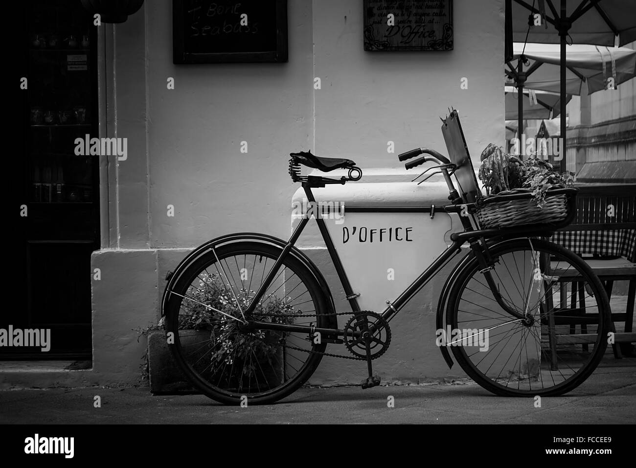 Bicycle Parked Against Wall - Stock Image