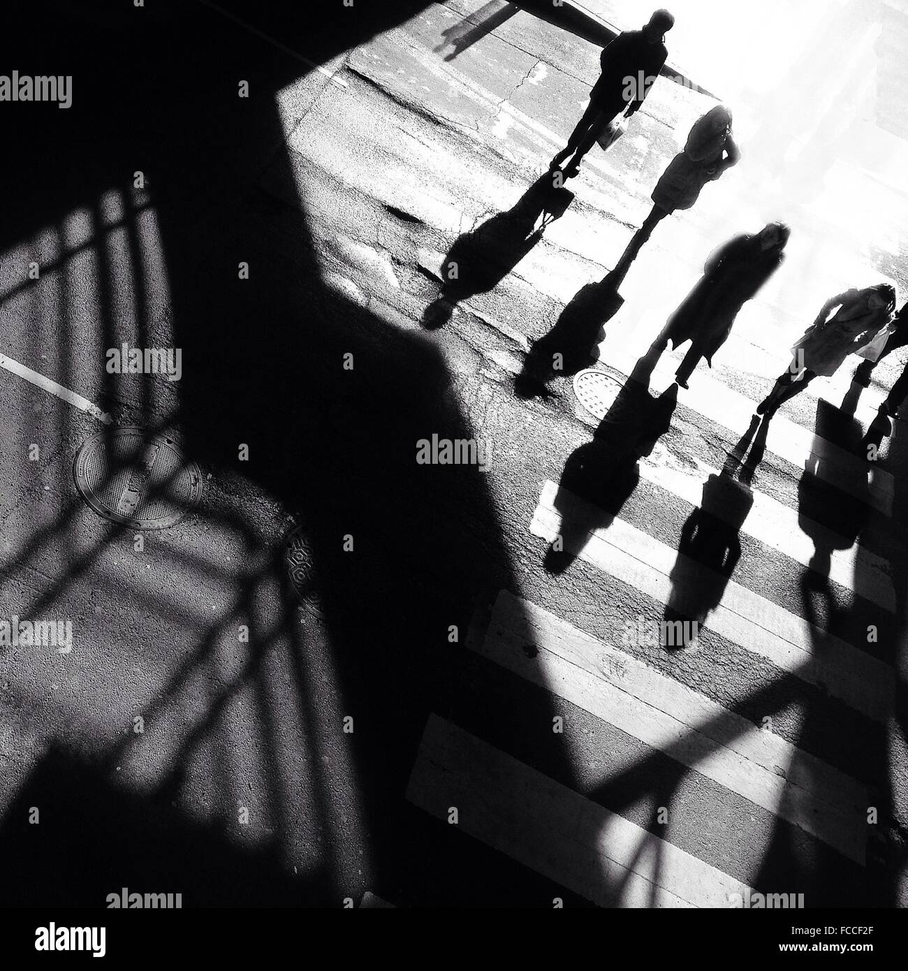 High Angle View Of People Walking On Zebra Crossing Stock Photo