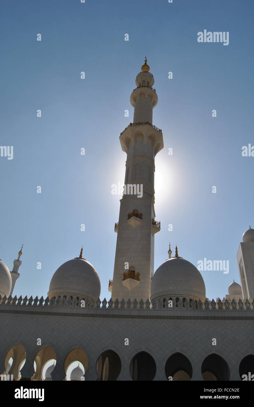 Minaret Of Sheikh Zayed Grand Mosque Against Clear Blue Sky Stock Photo