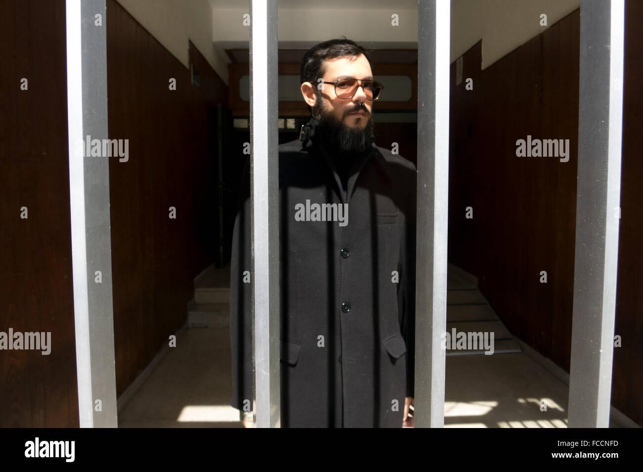 Portrait Of Man Standing In Building Seen Through Window - Stock Image