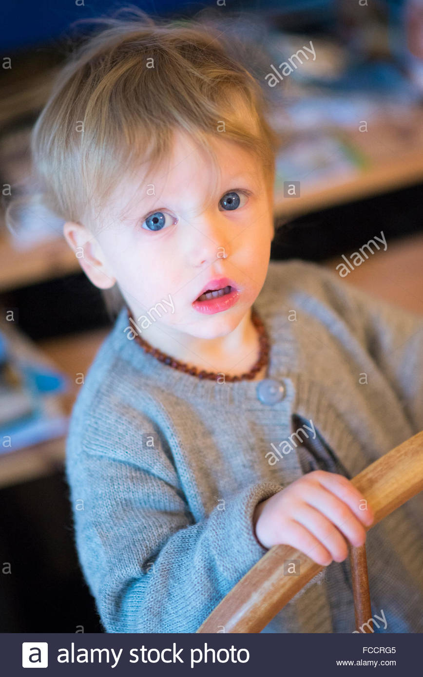 inquisitive expression of young boy - Stock Image