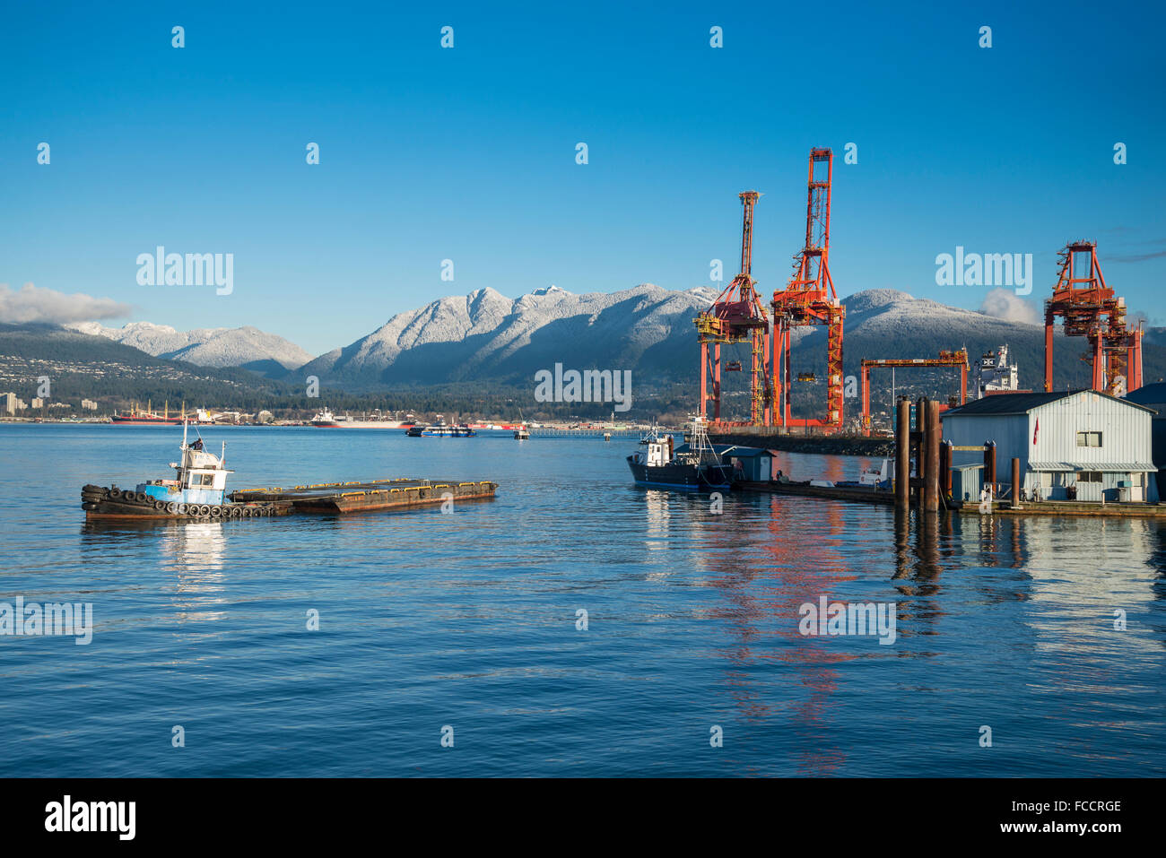 Tug boat moving  dock, Vancouver waterfront, Vancouver, British Columbia, Canada - Stock Image