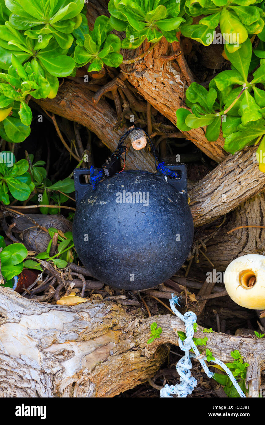 Nautical and marine floats and ropes wash ashore at Bathtub Beach on the North Shore of Oahu Hawaii. - Stock Image