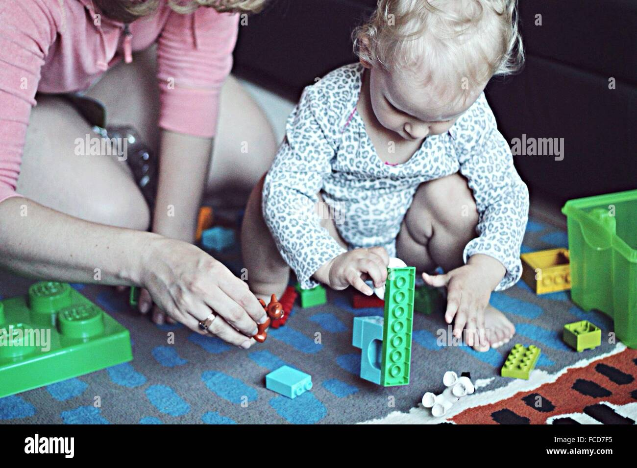 Low Section Mother Playing With Child At Home Stock Photo