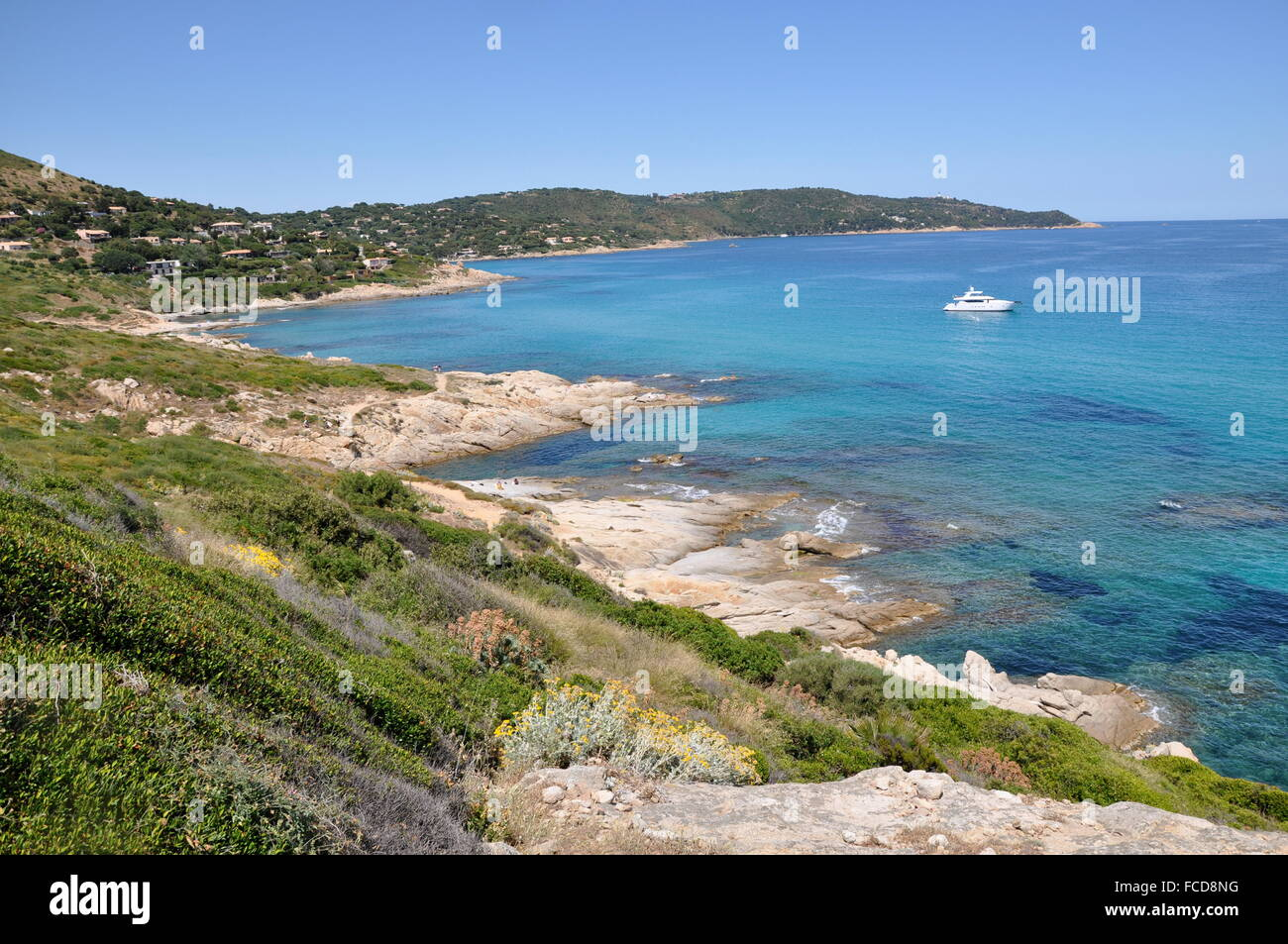 View Of Yacht Anchored Next To Shore - Stock Image