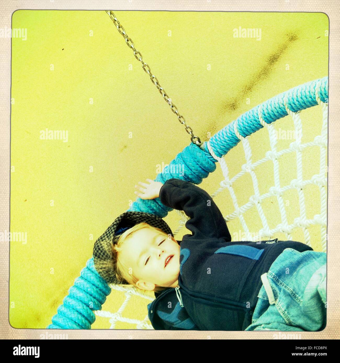 Boy Relaxing On Swing Chair Stock Photo