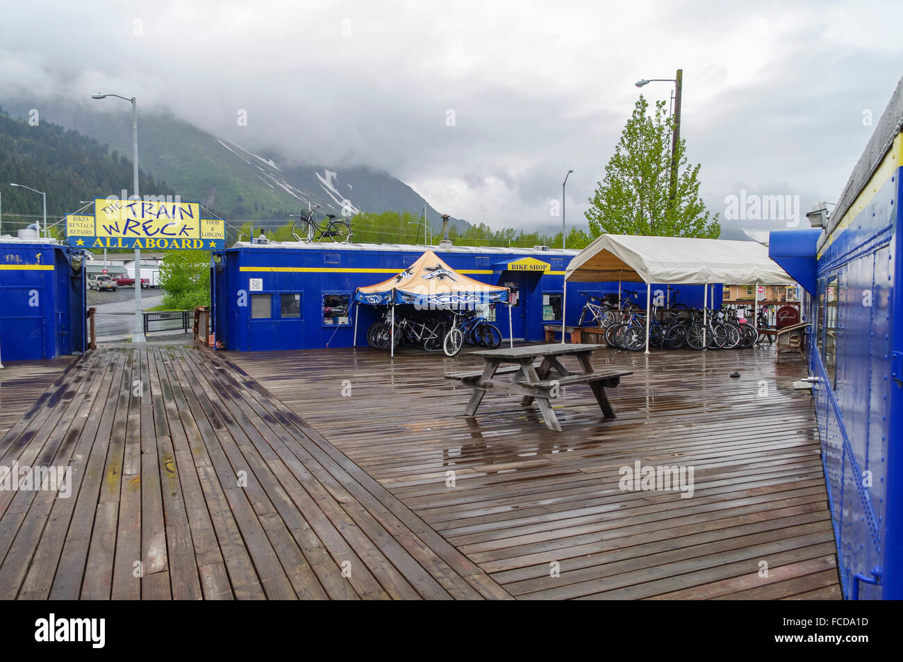 The Train Wreck in Seward, Alaska, United States. Old Alaska Railroad coaches reused as small shops and a restaurant. - Stock Image