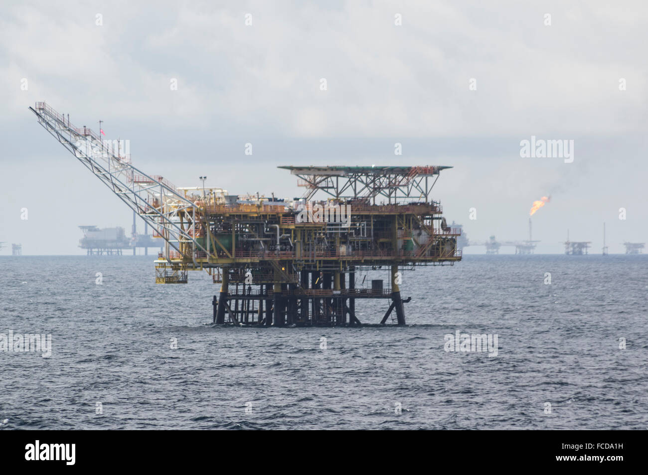 Oil rig off the coast of Brunei Darussalam, in the South China Sea. Many more offshore oil rigs in the background. Stock Photo