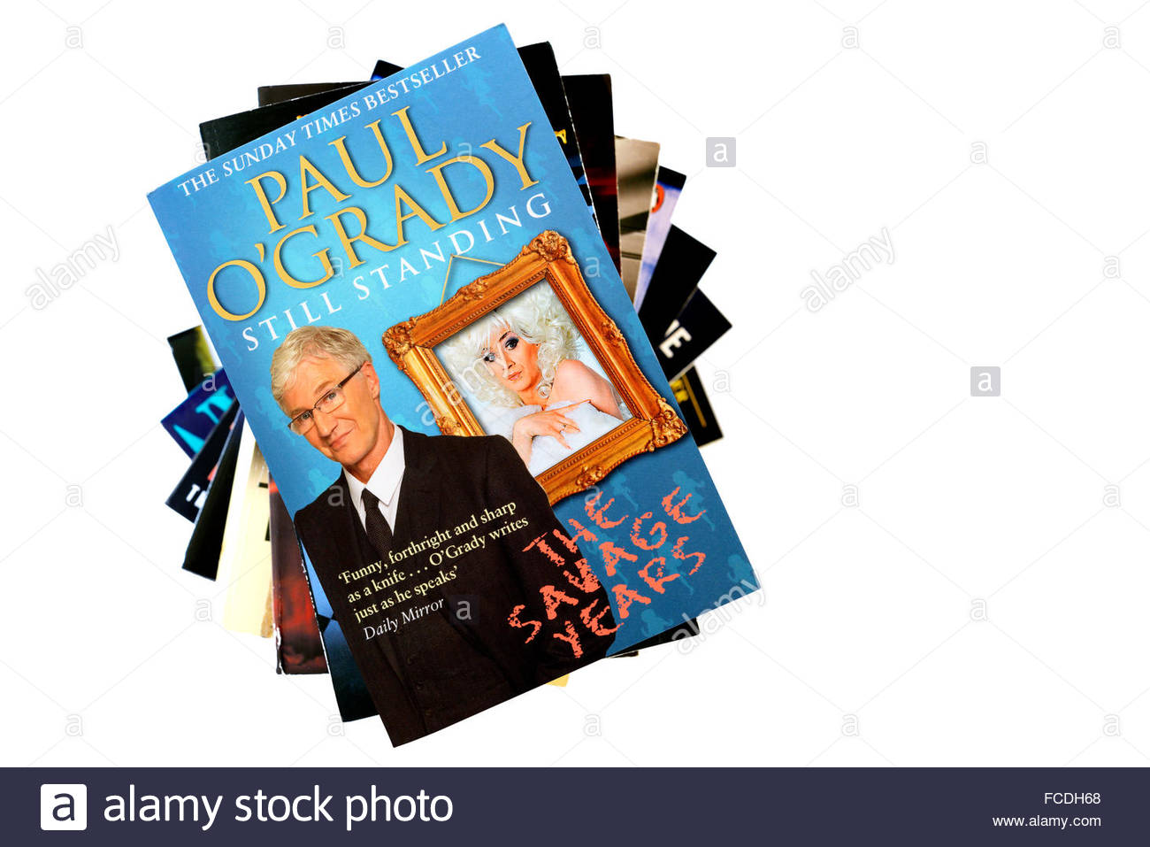 Paul O'Grady 2012 autobiography Still Standing, stacked used books, England Stock Photo