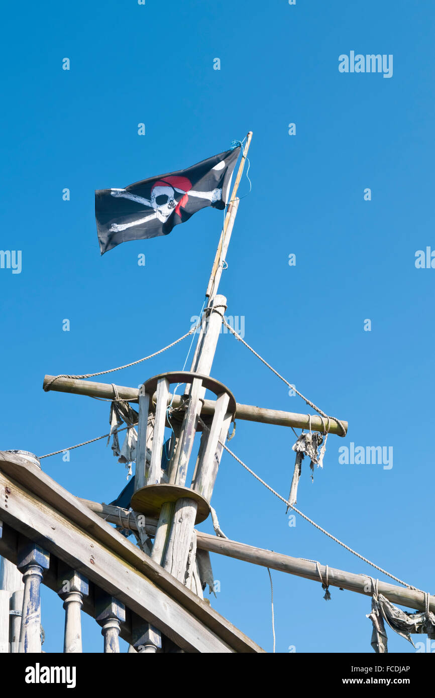 53a6737430c A pirate flag flying from the mast of a galleon in a children s play park -