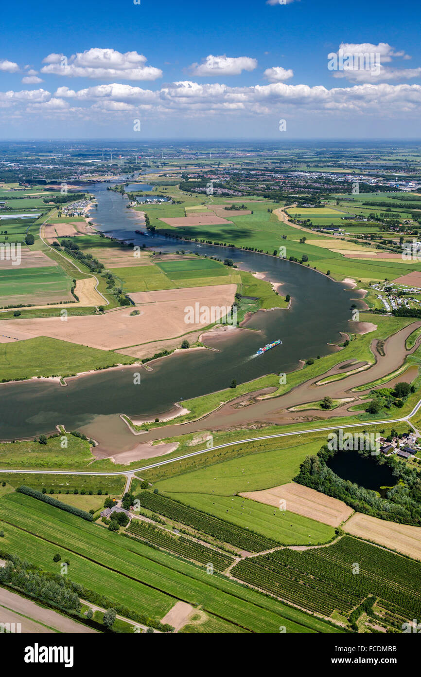 Netherlands, Lexmond, Cargo boat in river Lek. Aerial - Stock Image