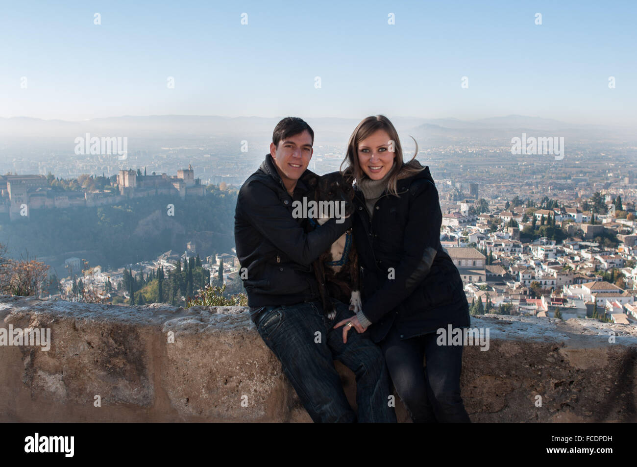 Portrait Of Heterosexual Couple Against Cityscape - Stock Image