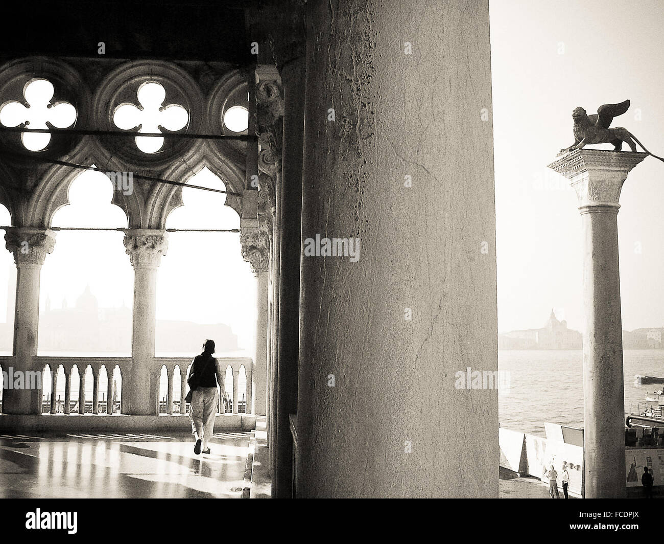 Full Length Rear View Of Woman Walking In Historic Building - Stock Image