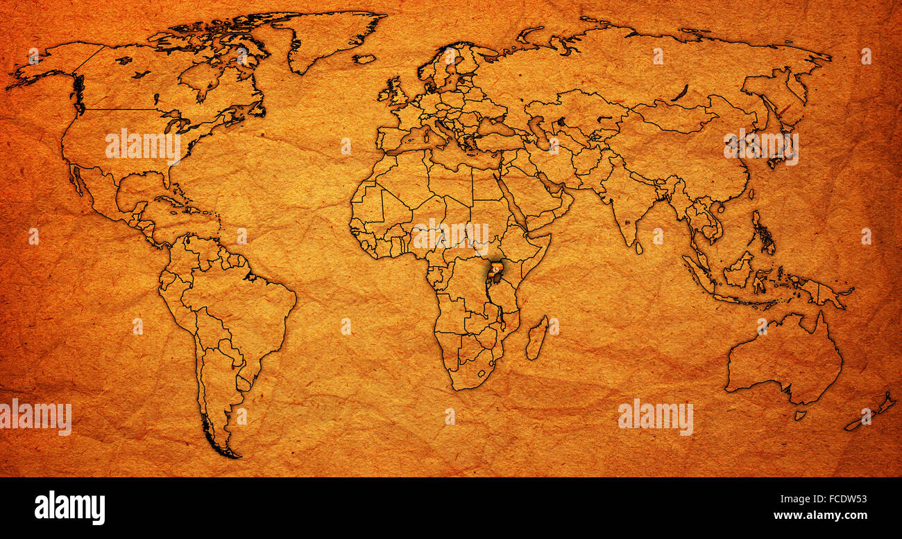 uganda flag on old vintage world map with national borders Stock ...