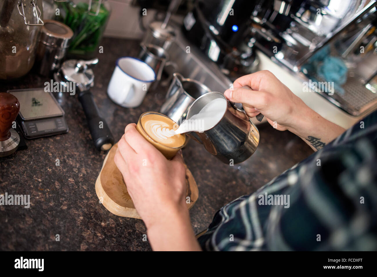 Barista Making The Perfect Flat White - Stock Image