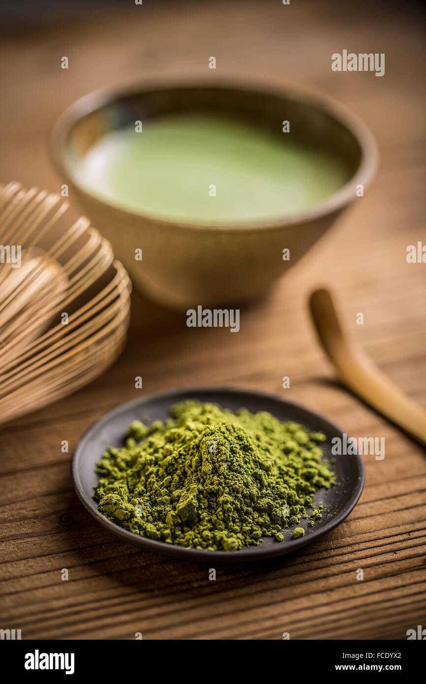 Matcha, powder green tea in black plate - Stock Image