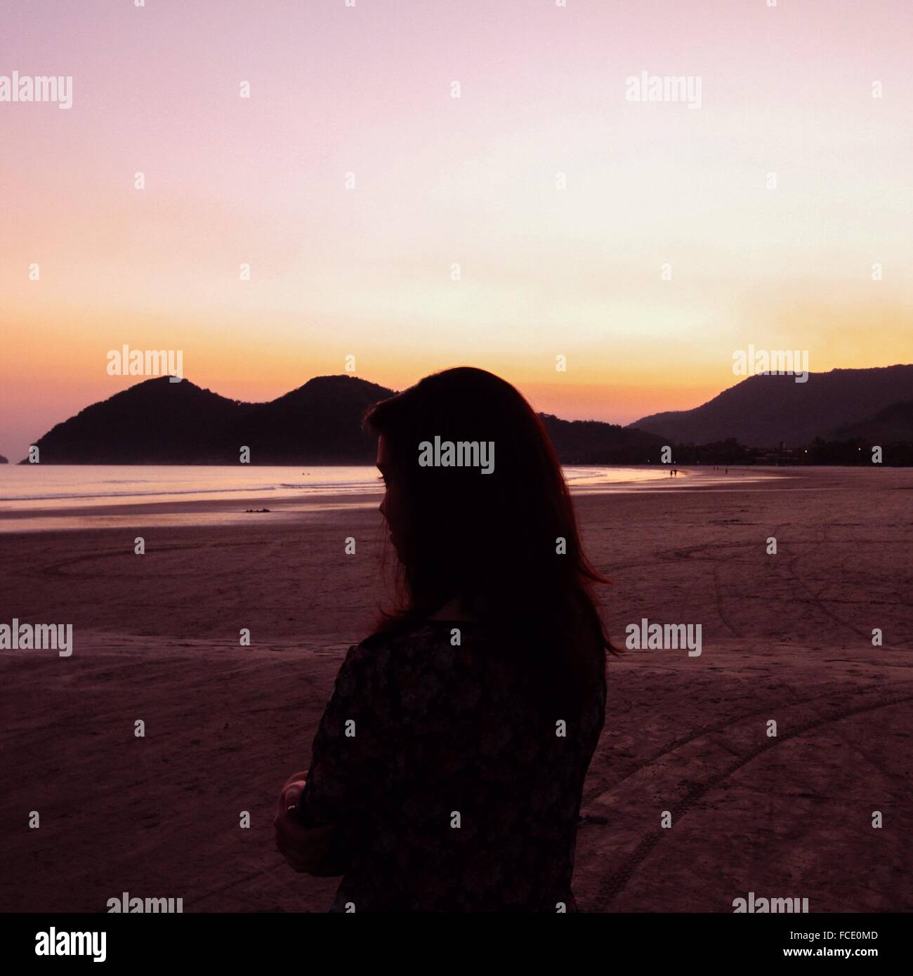 Silhouette Of Woman On Beach - Stock Image