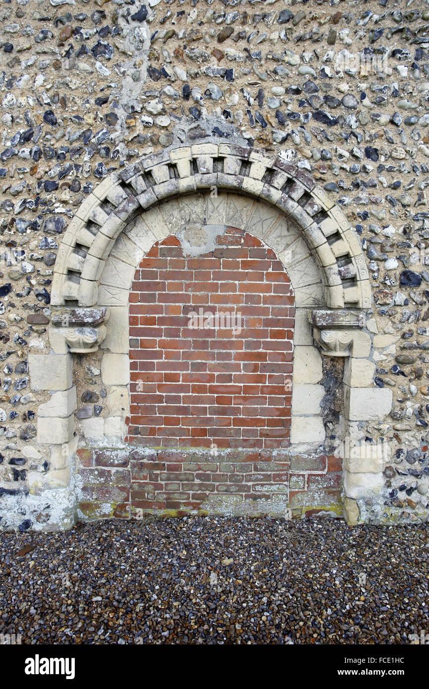 Norman north door, now bricked up. St Edmund's Church, South Burlingham, Norfolk Stock Photo