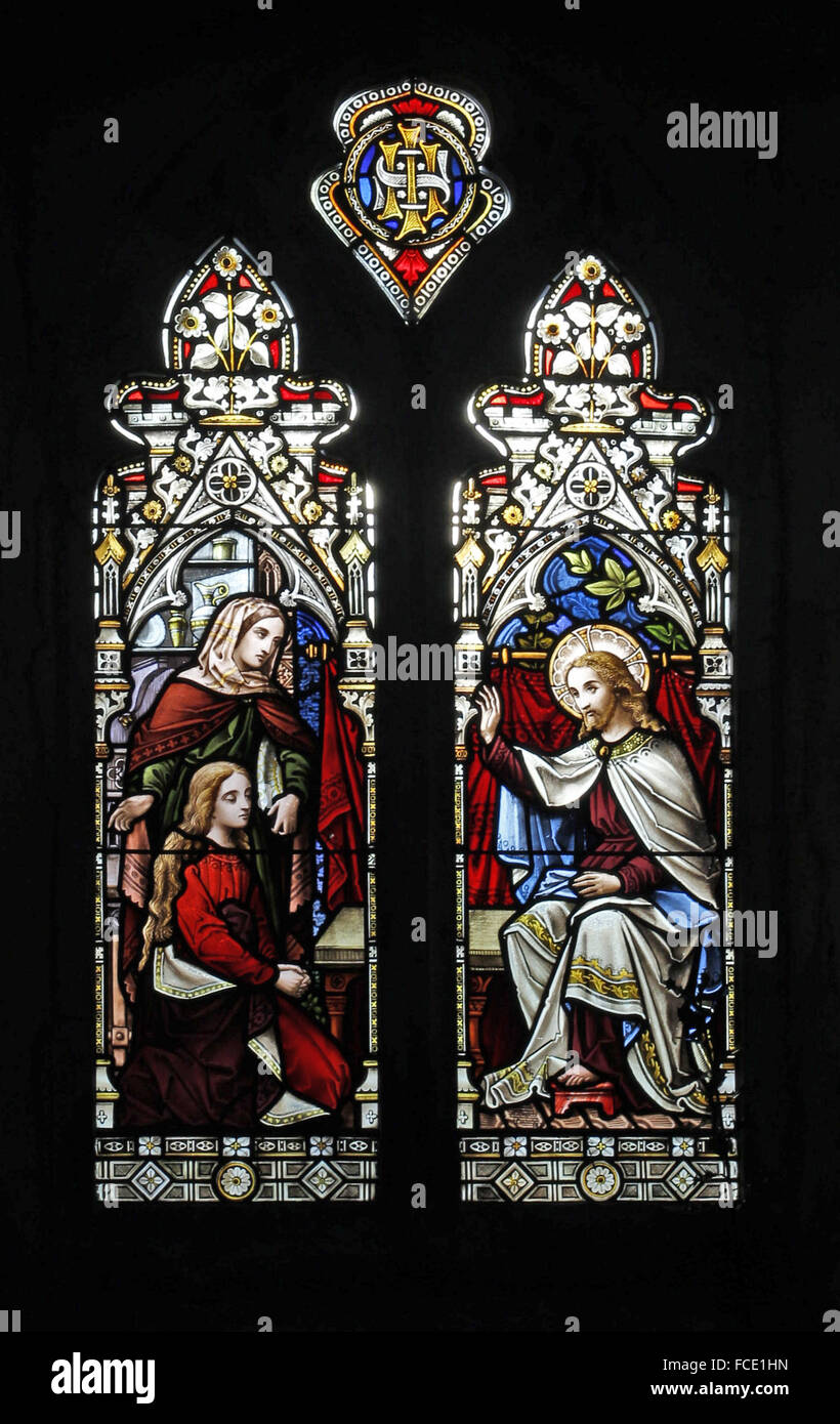 Stained glass window depicting the Parable of Mary and Martha, All Saints Church, Beighton, Norfolk - Stock Image