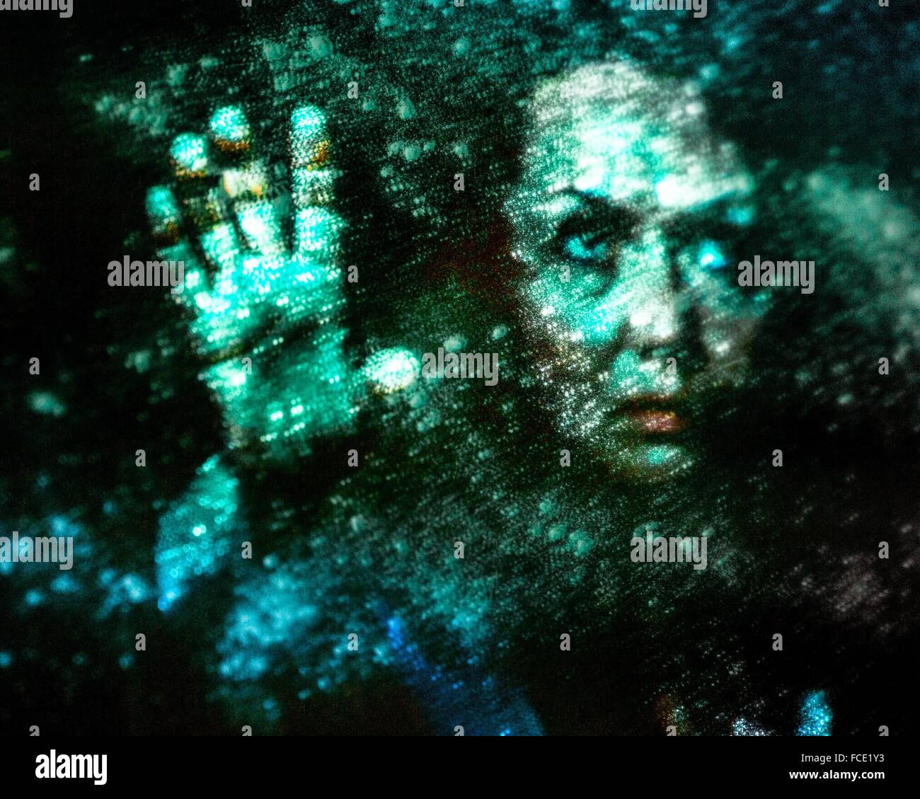 Digital Composite Of Spooky Woman Touching Wall - Stock Image