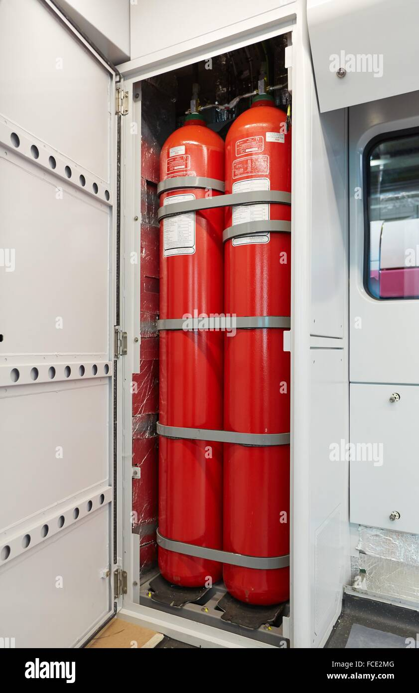Bottles of water. Anti fire safety. Interior of train. - Stock Image