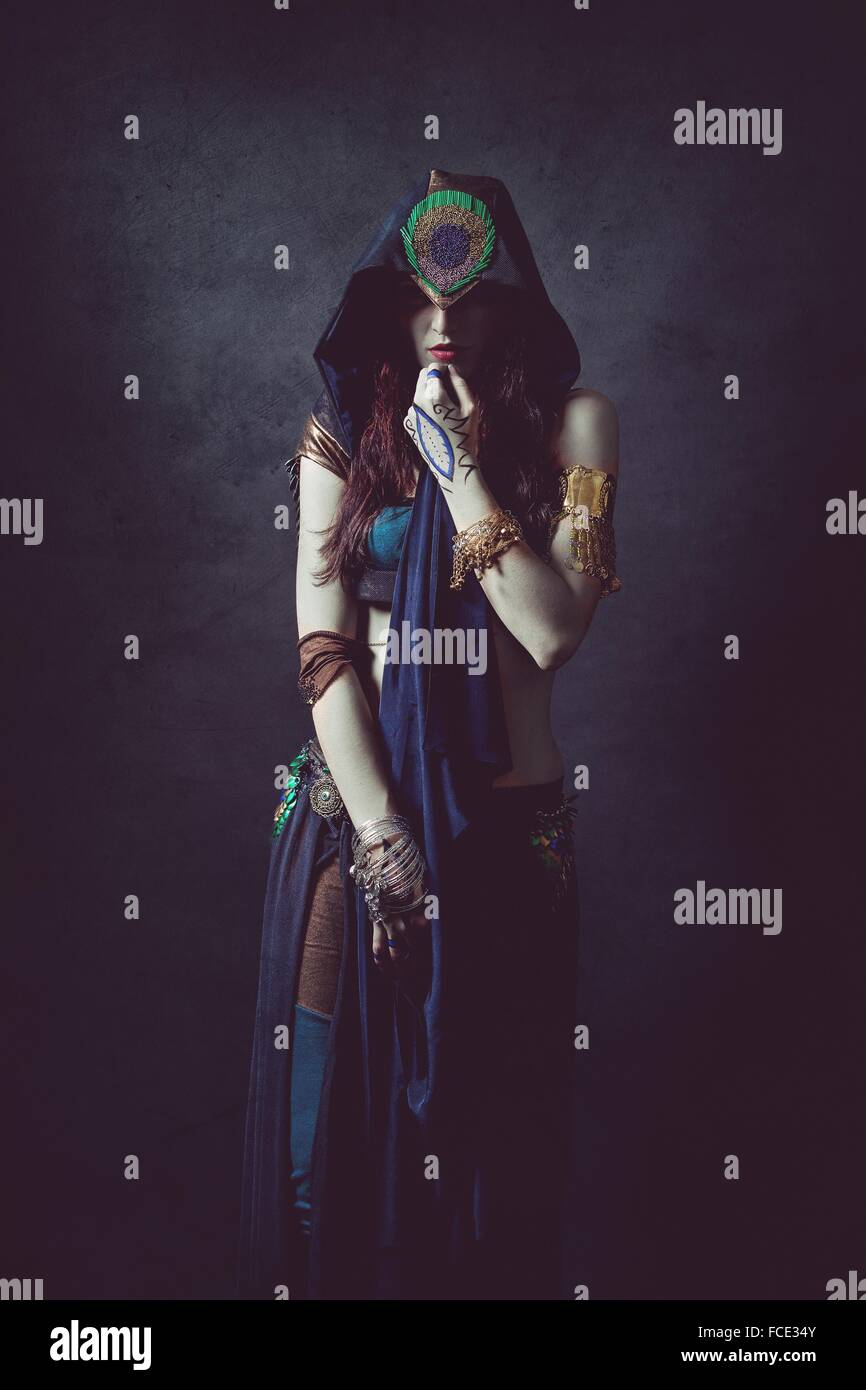 Mystical woman in ethnic dress - Stock Image