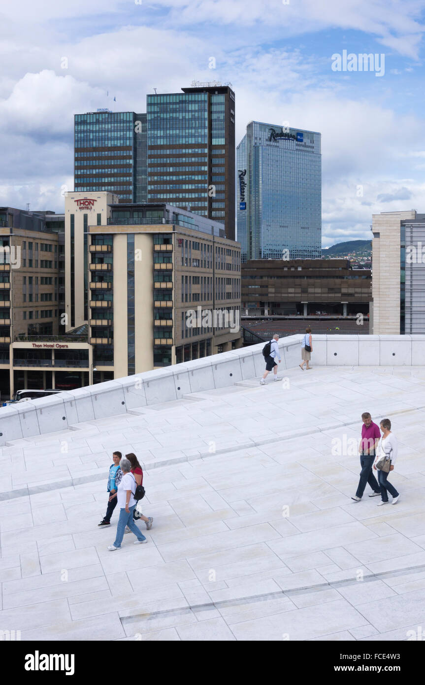 People walking on the roof of the Oslo Opera House, Oslo, Norway - Stock Image