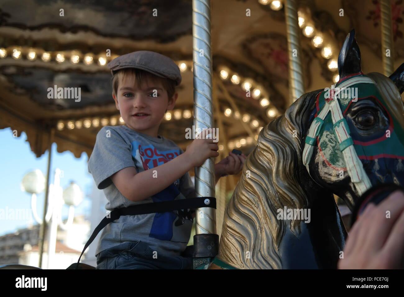 658df841d Boy Enjoying A Carousel Ride Stock Photos & Boy Enjoying A Carousel ...