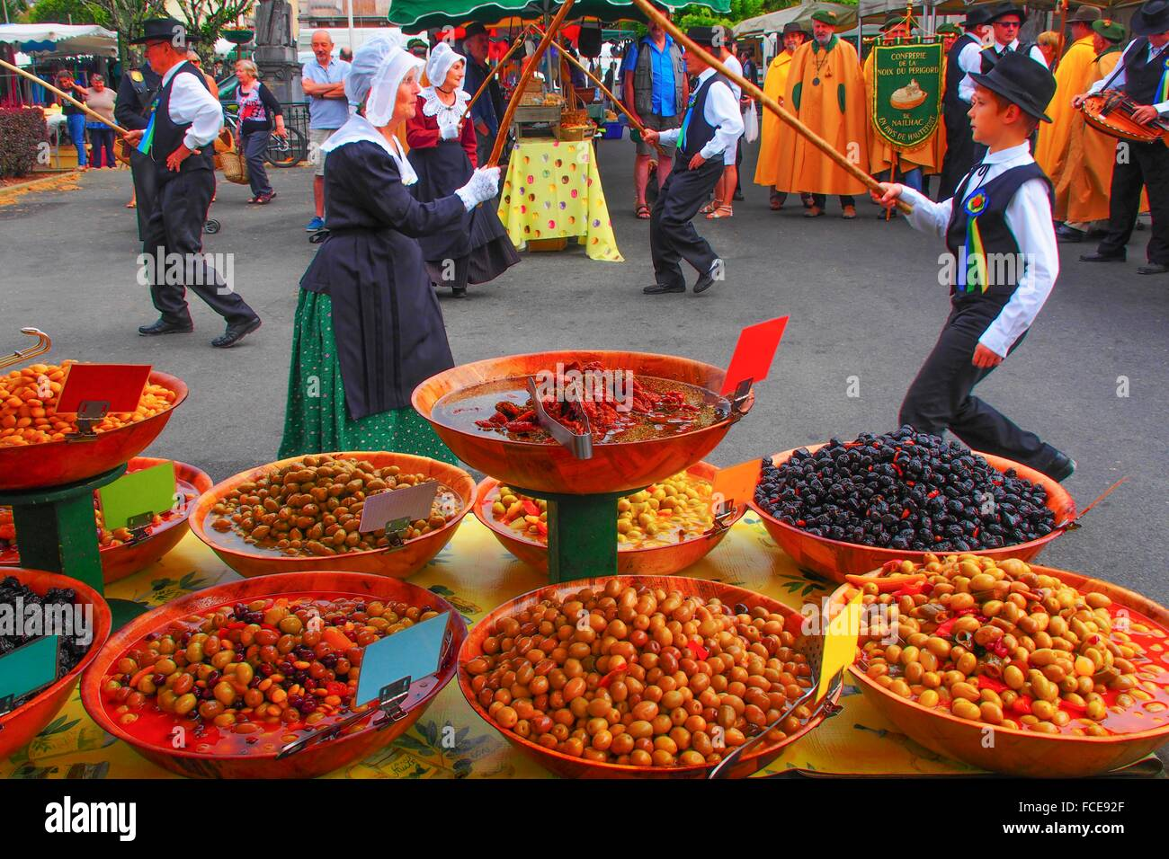 France-Aquitaine-Dordogne- Local folcloric dance group , on the open air market at Thenon. - Stock Image