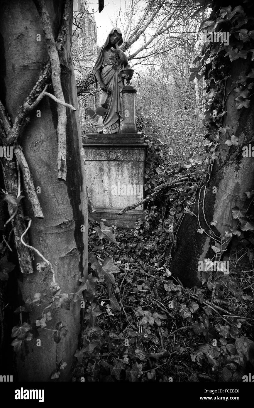 Black and white photography of the obituary symbolism of a grave with a female figure in abney park cemetery stoke newington