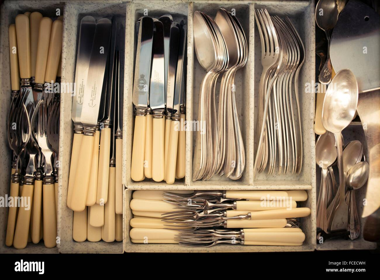 Cutlery In A Drawer Full Of Silverware. Fish Cutlery, Knives, Spoons,  Holders, Dessert Cutlery, Coffee Spoons And Several