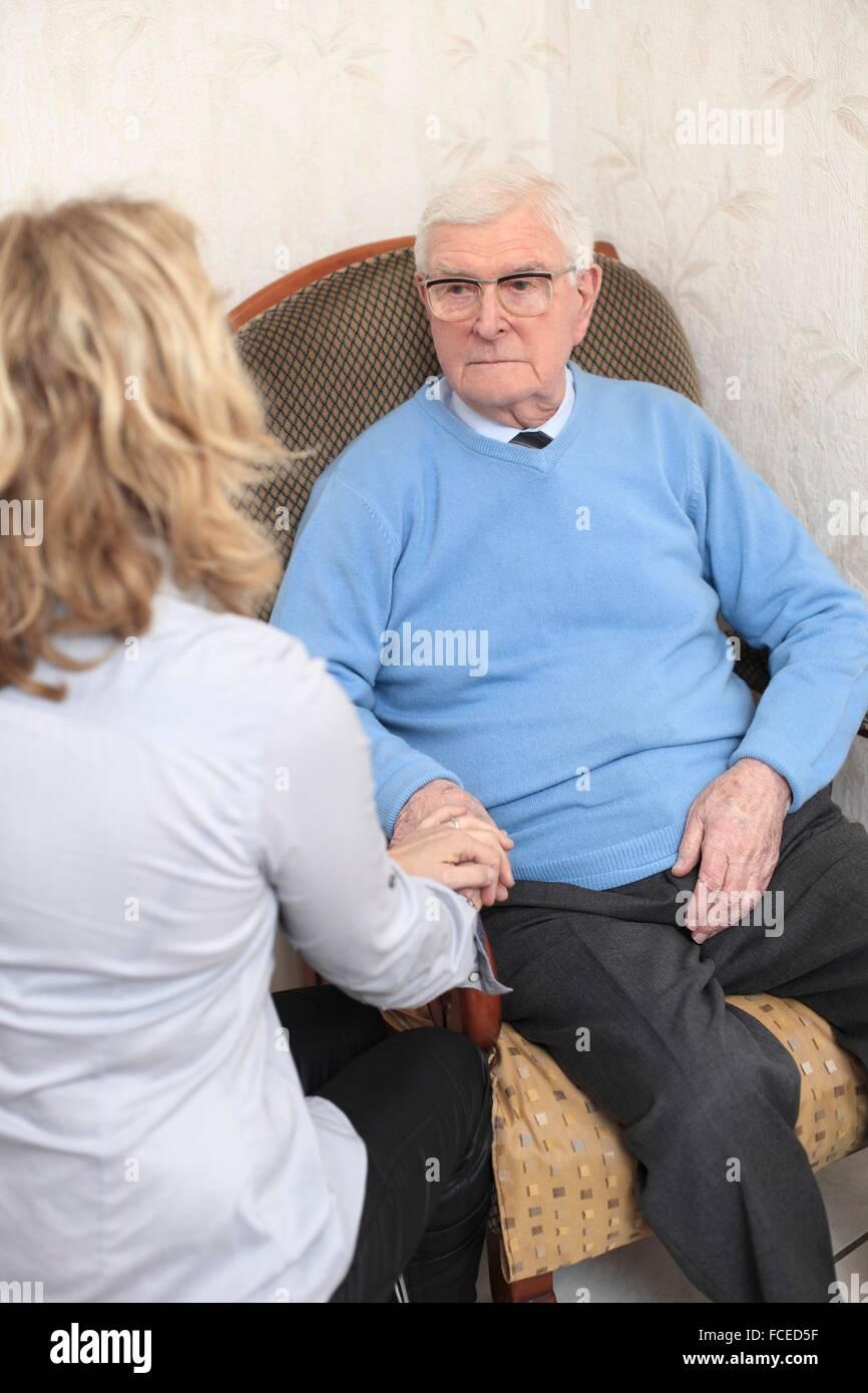 France, woman comforting elderly - Stock Image