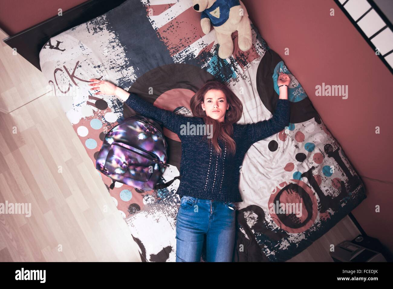 France, teenager at home, tired after school - Stock Image