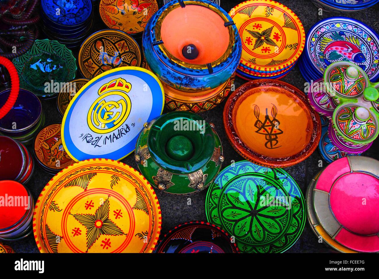 Ceramics with islamic designs and a plate with Real Madrid football team´s logo, Morocco - Stock Image