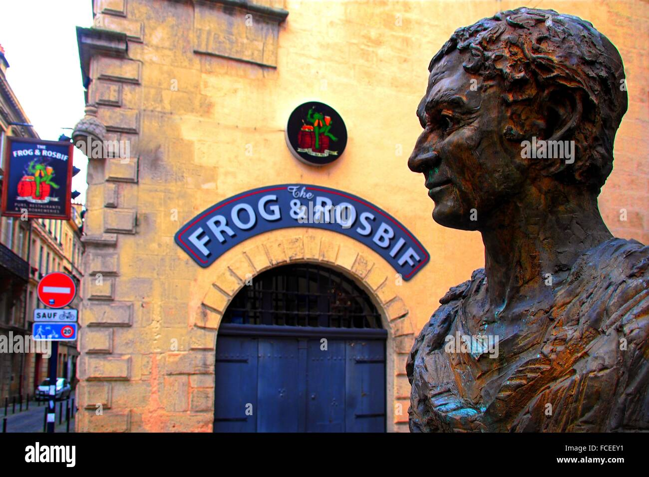 Statue of the Roman poet Ausonius and English pub sign on