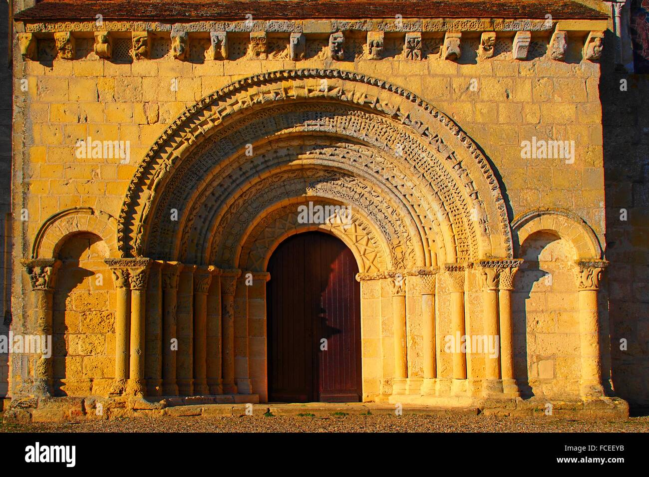 Lateral entrance door to the Romanesque church of Saint Martin de Sescas, 12th century, Gironde, Aquitaine, France - Stock Image