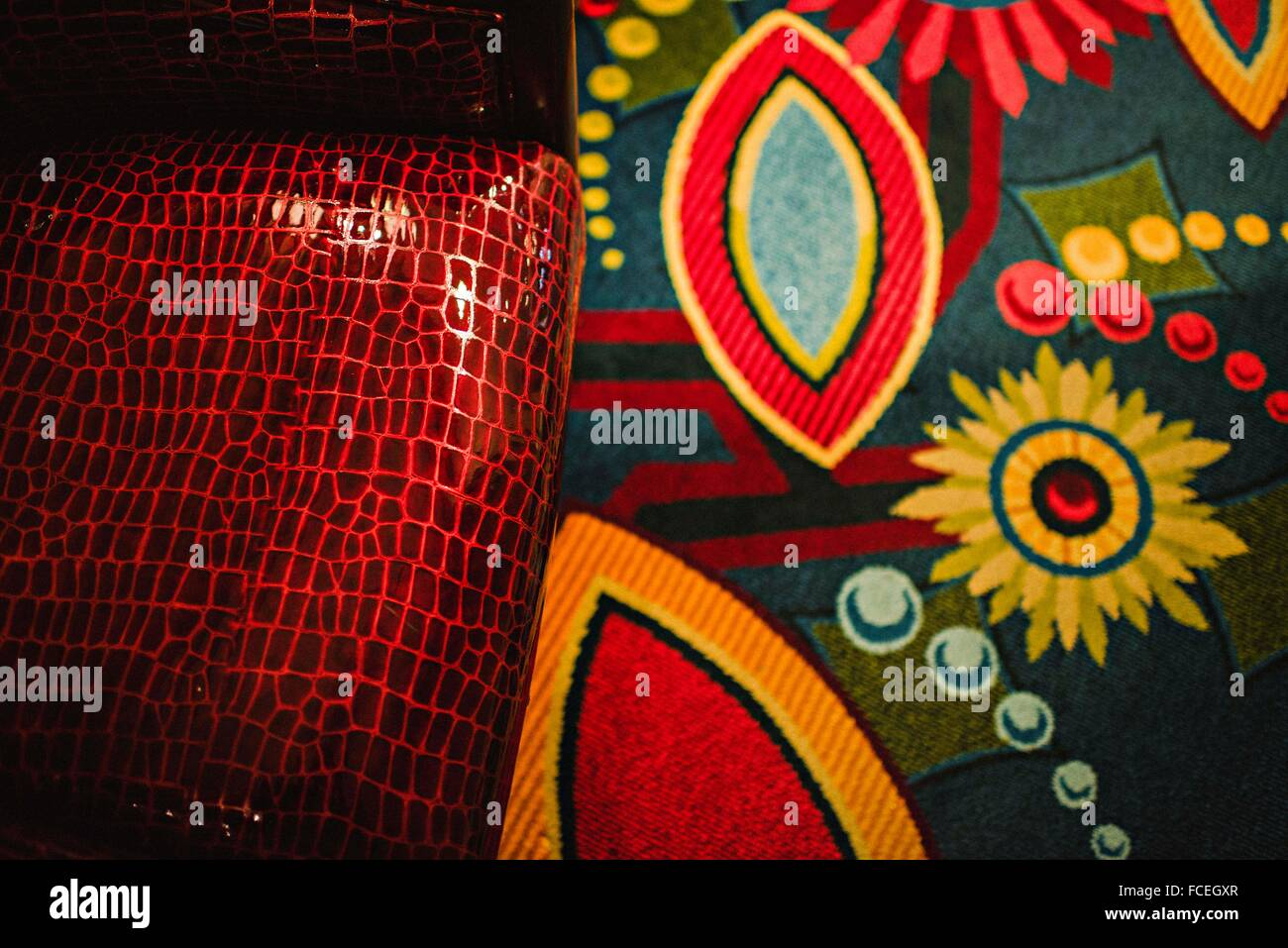 Close-Up Of Red Purse On Bed Sheet - Stock Image
