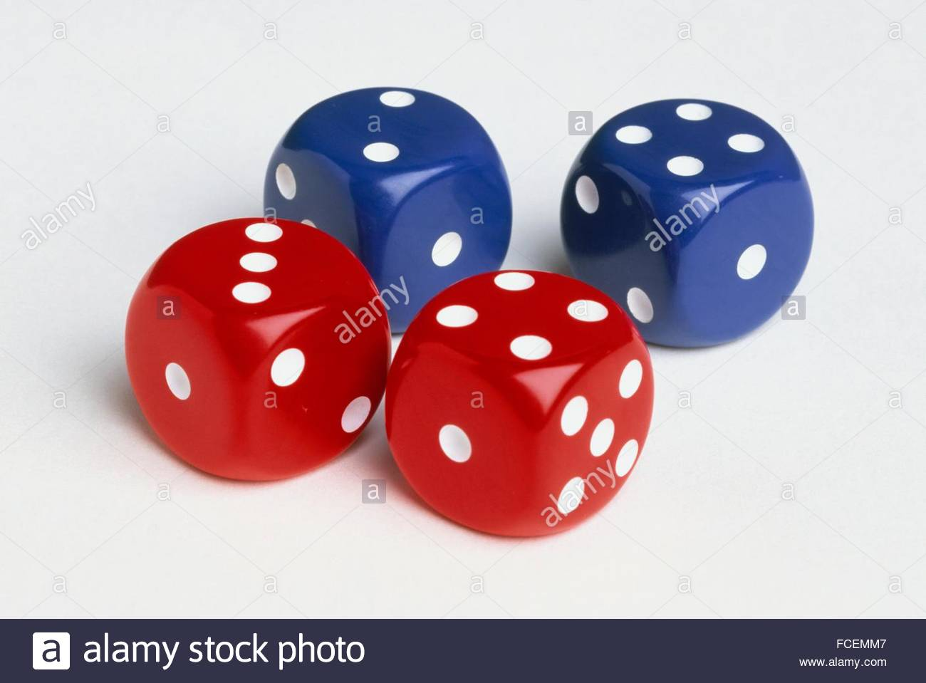 Four red and blue dice - Stock Image